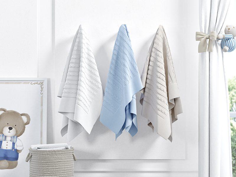 g-8-5-manta-tricot-apoiada-na-parede-1